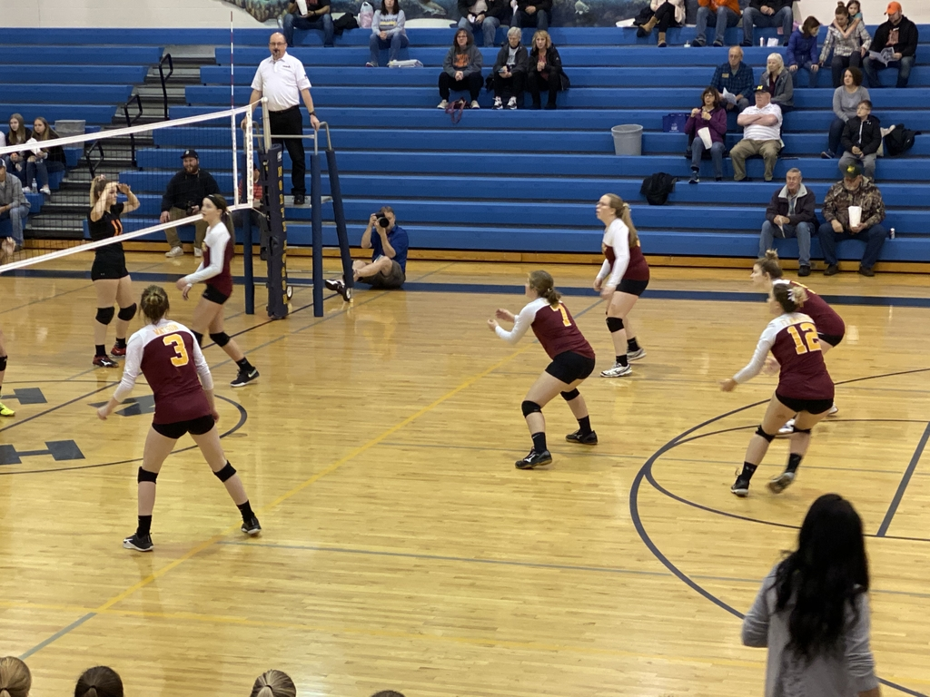 District volleyball action